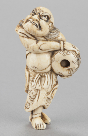 Bone netsuke depicting a sennin grasping a mokugyo, Kyoto, mid-18th century. Provenance: F. Meinertzhagen. Est. $12,000-$18,000. Quinn's Auction Galleries image.