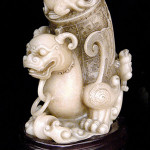 Fine Ming Dynasty shoushan stone carving of a qilin with rhyton vessel on its back. The mythical beast has bulging eyes under bushy brows and short antlers with suspended loose rings under the chin. Gianguan Auctions image.