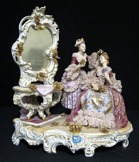 Meissen-style figurine on platform depicting two ladies at the dressing table. The Specialists of the South Inc. image.