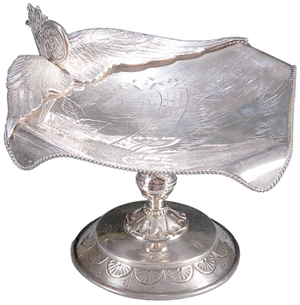A short poem that starts with the words 'Speed away' is inscribed on this 6-inch-high silver-plated card tray. It sold for $338 at Jackson's International Auctioneers in Cedar Falls, Iowa, a few years ago.