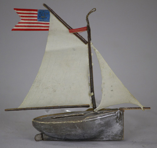 A German ornament made for the American market: this silver Dresden sailboat flying the US flag brought $1,600 (on the hammer) in Bertoia Auctions' September 2012 sale. Photo courtesy Bertoia Auctions.