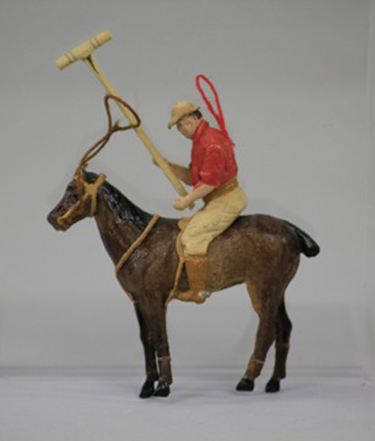 Dresden polo player on horseback, realistically detailed with mallet ready to strike. Collection of Catherine Saunders-Watson.
