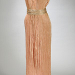 Signed Mariano Fortuny silk pleated 'Delphos' gown with Venetian glass beadwork, circa 1910, Venice, Italy, length approximately 64 inches. Estimate: $4,000-$5,000. Skinner Inc. image.