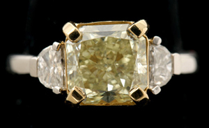 Fancy yellow diamond, near colorless diamond, platinum, 18K yellow gold ring. Sold for $18,880. Michaan's Auctions image.