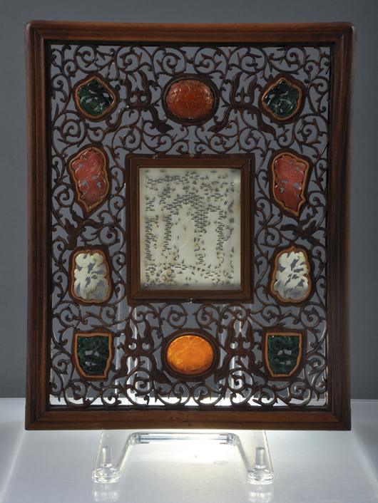 Chinese carved hardwood screen with inset jade panels, 19th century. Estimate: $2,000-$4,000. John McInnis Auctioneers image.