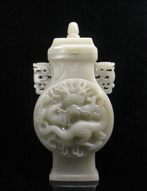 Chinese white jade carved vase with dragon motif, Qing Dynasty, size: 17 x 9 x 3.2 centimeters. Estimate: $35,000-$45,000. Antiques Gallery image.