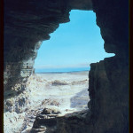 A view of the Dead Sea from a cave at Qumran in which some of the Dead Sea Scrolls were discovered. Image by Eric Matson, courtesy Wikimedia Commons.