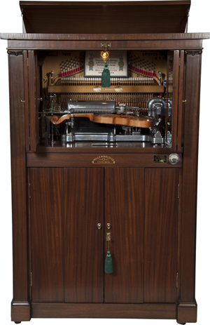 Coin-operated Mills Novelty Violano Virtuoso musical entertainment machine, circa 1907, combination violin and piano concert. Victorian Casino Antiques image.