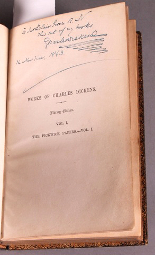 Inscription hand-written by Charles Dickens in 1863 on the title page of Volume I, Works of Charles Dickens. Waverly Rare Books image.
