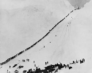 Historical photograph of miners and prospectors climbing Alaska's Chilkoot Trail during the Klondike Gold Rush, September 1898. The trail ran from Dyea, Alaska to Bennett, British Columbia, in Canada, and led to the Yukon goldfields. The trail became obsolete in 1899 when a railway was built along a parallel trail.