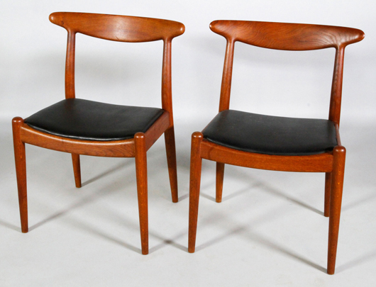 Pair of Hans Wegner designed side chairs, oak with black leather seats, early 1960s, each with branded mark under seat, C.M. Madsens Fabriken, Haarby, Denmark. Estimate: $800-$1,200. Kaminski Auctions image.