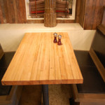A New York City eatery utilized bowling lanes from Pioneer Millworks for their tabletops. PRWEB image.