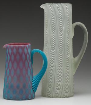Rare Phoenix Glass Co. pitchers from a large collection of Phoenix wares. Jeffrey S. Evans & Associates image.