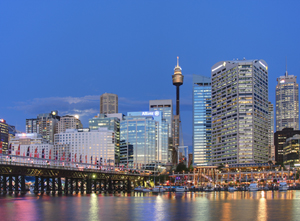 The moon rises over Sydney and Darling Harbour. Image by Adam.J.W.C. This file is licensed under the Creative Commons Attribution-Share Alike 2.5 Generic license.