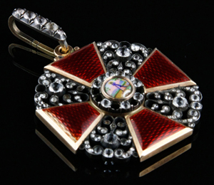 Russian St. Anne medal, enamel, gold and diamonds, the red guilloche cross and openwork panels set with 106 rose cut diamonds, 18K gold hanging ring. Price realized: $59,000. Kaminski Auctions image.