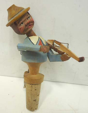 Figural stopper collection handmade by Italian carvers