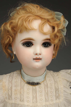 French bisque bebe doll incised 'Eden Bebe Paris 9,' 23 inches, $18,000. Morphy Auctions image.