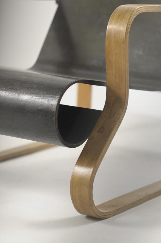 Closeup view of Alvar Aalto bentwood armchair. Sworders image.