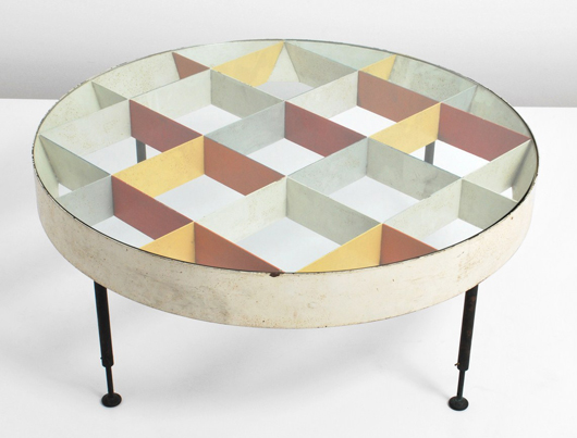 Cocktail table in the manner of Gio Ponti (Italian, 1891-1979) pictured in 'Domus, Taschen 1955-1959,' pg. 112. Auctioned for $40,800. Palm Beach Modern Auctions image.