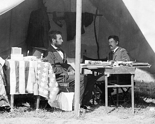 President Abraham Lincoln, his stovepipe hat by his side, and Gen. George B. McClellan at Antietam, Md., Oct. 3, 1862. Image courtesy Wikimedia Commons