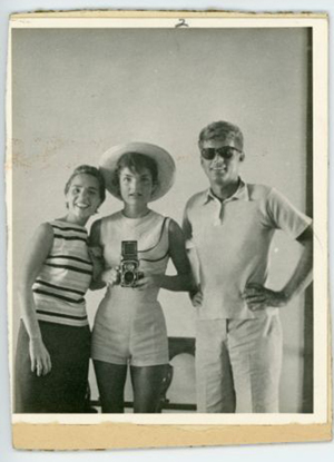 Photo of Ethel Kennedy, Jackie with camera and John Kennedy. John McInnis Auctioneers image.