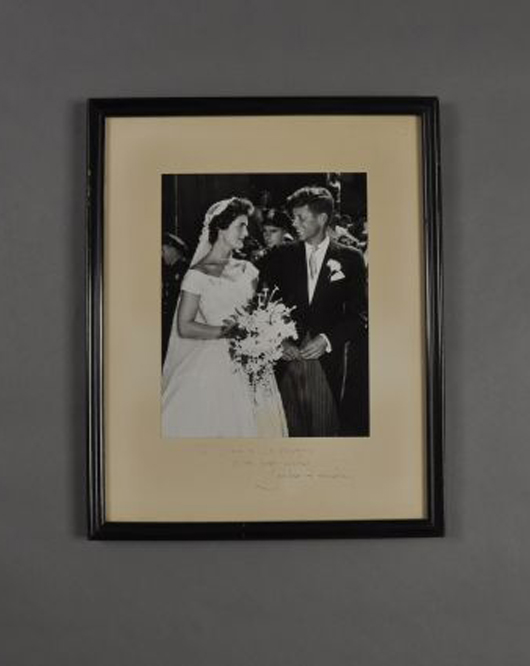 John F. Kennedy and Jacqueline on their wedding day. John McInnis Auctioneers image.