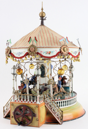Exquisitely detailed circa-1910 Marklin carousel, crank or steam driven, top lot of the sale, $218,500. Noel Barrett Auctions image.