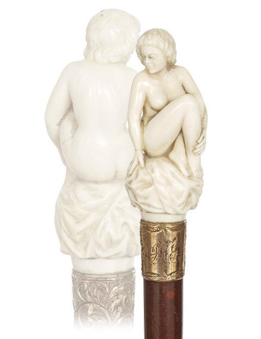 Erotic nude cane, circa 1890, large ivory seated Venus handle on a malacca shaft with a brass ferrule and a richly chased and gilt collar with engraved initials. Estimate: $3,000-$4,000. Kimball M. Sterling Inc. image.