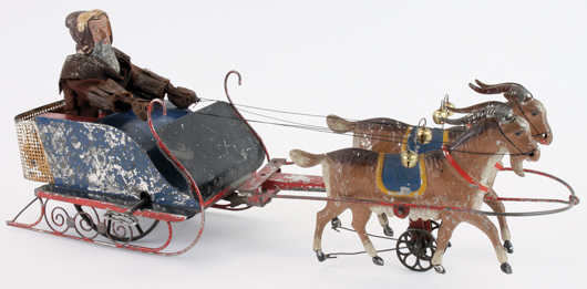 Althof Bermann hand-painted tin Santa in Sleigh, one of only two known examples considered 100% original, $97,700. Noel Barrett Auctions image.