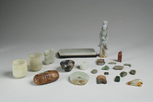 Group of 22 Chinese jade and hardstone objects including a figure, a pendant, two cups, a mounted plaque,  rings and other small examples. Sold: $17,360 (Estimate: $1,000-2,000). Keno Auctions image.