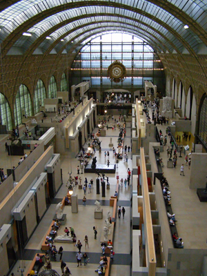 The interior of Musee d'Orsay, a former railroad station in Paris. Image by Krzysztof Mizera, courtesy of Wikimedia Commons.