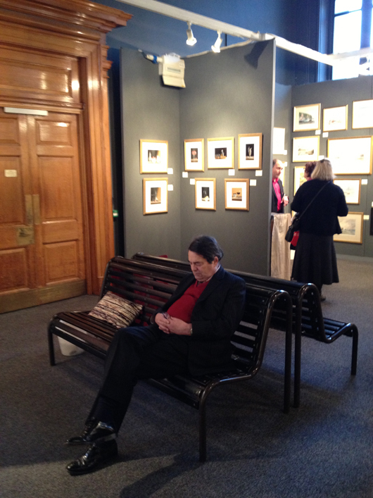 A visitor to the Watercolour and Works on Paper Fair at the Science Museum in London grabs some well-earned shut-eye. Image Auction Central News.