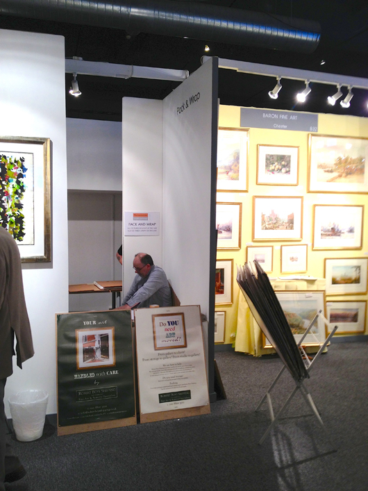 The wrapping booth at the Watercolour and Works on Paper Fair, which reported a steady dream of purchasers wanting its services on the fair's opening day. Image Auction Central News.