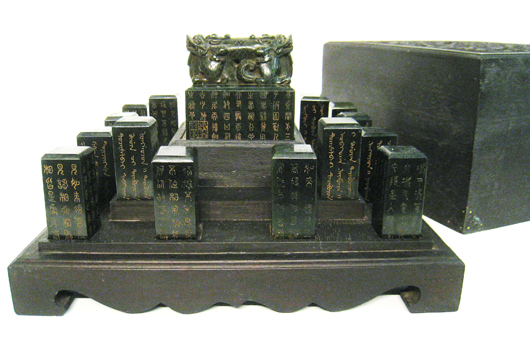 Large Chinese Qing Imperial green jade central seal with 18 smaller seals, all in a zitan box. Price realized: $14,400. Gordon S. Converse & Co. image.