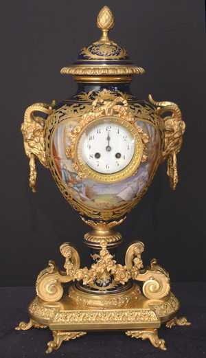 Rare 19th century Sevres clock in urn form, hand-painted and artist-signed, 26 inches tall. Stevens Auction Co. image.