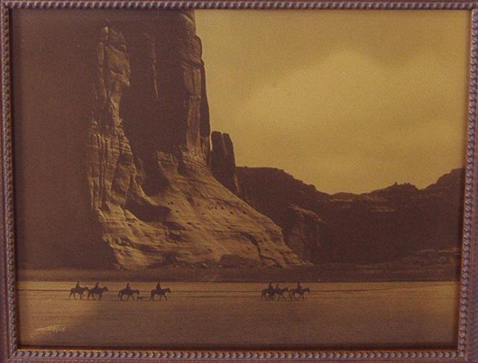 This gold tone print of a mounted party passing through Canyon de Chelly sold for $4,800 at Klein James' Seattle Auction Gallery last April. Another gold tone image of the same view brought $7,260 at the recent High Noon Western Americana Auction. Courtesy Klein James Auctions.