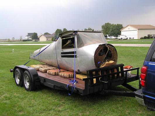 The fuselage is hauled to Koerner Aviation in Kankakee, Ill., for restoration. Koerner Aviation image.