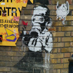 Photo of a Banky work in Brick Lane, East End, in 2004. Image by Matt Whitby, courtesy of Wikimedia Commons.