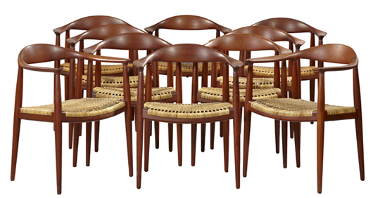 Set of 10 Hans Wegner carved teak Mid-Century Danish Modern arm chairs, with caned seats. Crescent City Auction Gallery.