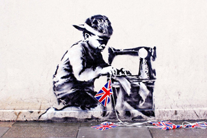 Banksy, 'Slave Labour (Bunting Boy),' stencil and spray paint on render with additional Golden Jubilee bunting, 48 x 60 in. Unique street work. Image courtesy of LiveAuctioneers.com and Fine Art Auctions Miami.