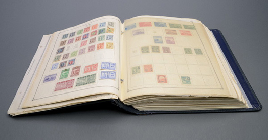 Collection of Chinese stamps in a Scott's album. Price realized: $5,900. Michaan's Auctions image.
