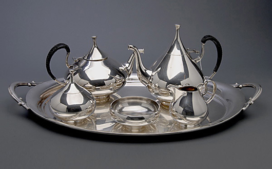 Modernist Reed & Barton five-piece coffee and tea service with tray. Price realized: $3,245. Michaan's Auctions image.