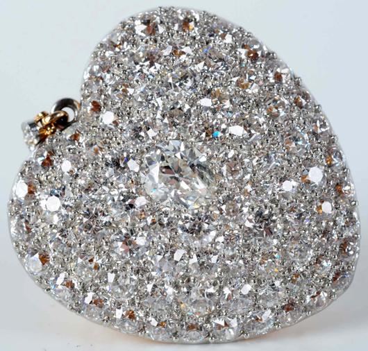 14K gold heart-shape pendant set with 1.25ct pear-shape center diamond, smaller rough-cut pave diamonds, $18,600. Morphy Auctions image.