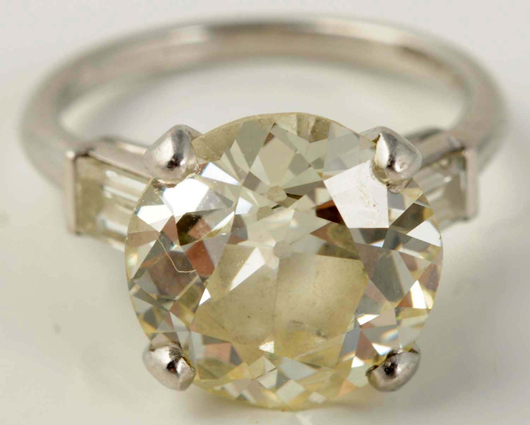 Platinum engagement ring with a 4.25ct European-cut diamond and two flanking baguettes, each weighing .30 carats, $19,800. Morphy Auctions image.