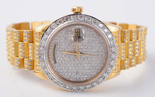 18K yellow gold and diamond men's Rolex watch, $10,800. Morphy Auctions image.