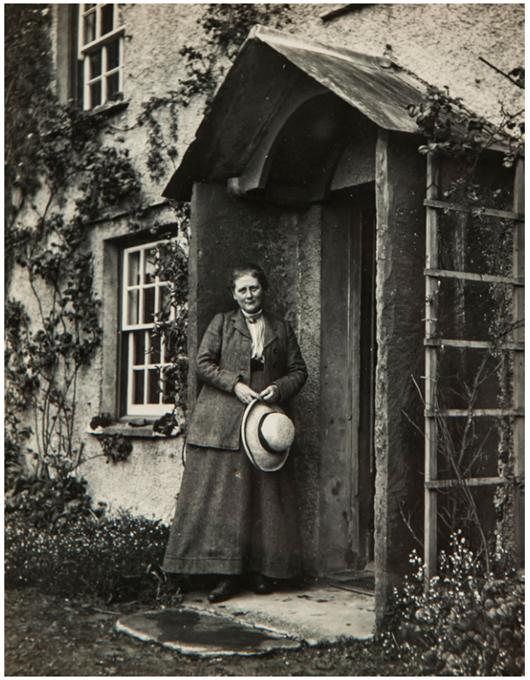Beatrix Potter in the doorway of Hill Top, 1913. Bloomsbury image.
