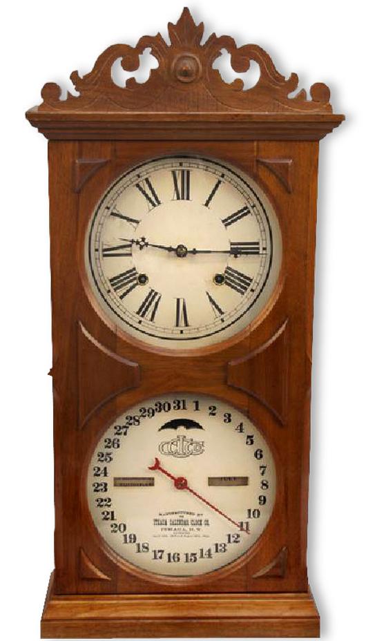 Antique Ithaca Calendar wood mantel clock. Government Auction image.