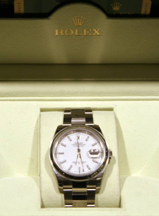 Rolex Datejust wristwatch with original box and papers. Government Auction image.