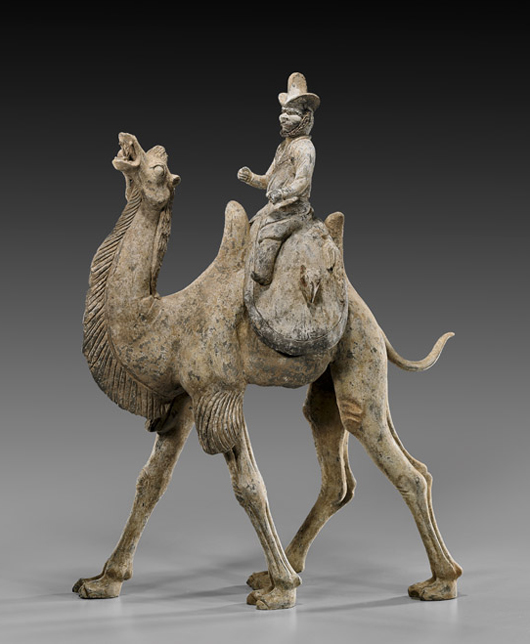 Early Tang Dynasty Bactrian camel with separate bearded rider on saddle, 28 1/8 inches tall, TL Test Certificate (Oxford). Estimate: $25,000-$35,000. I.M. Chait image.