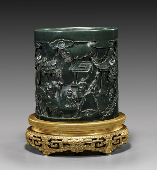 Large spinach jade brushpot, continuous landscape scene of sages in courtyard, 7 7/8 inches tall. Ex Cleveland Museum of Art Collection. Estimate: $35,000-$45,000. I.M. Chait image.